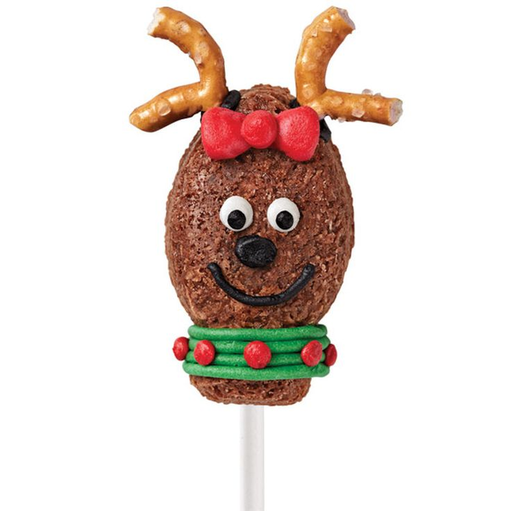 She?s all dressed up for Christmas Eve delivery! Use the Light Bulb Bite-Size Treat Mold to bake the fun brownie heads, then add cute decorating touches with pretzels and white Decorator Icing.