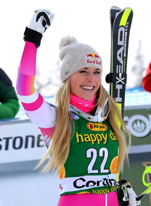 Lindsey Vonn celebrates after winning an alpine ski, women's World Cup super-G, in Cortina d'Ampezzo, Italy, Monday, Jan. 19, 2015. Lindsey Vonn won a super-G Monday for her record 63rd World Cup victory and celebrated with an embrace from a surprise visitor, boyfriend Tiger Woods.