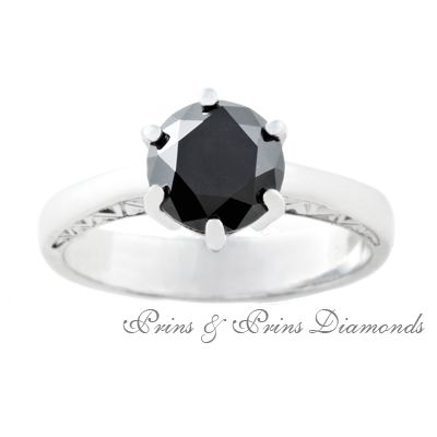 2.10ct black diamond with engraved detail on an 18k white gold band