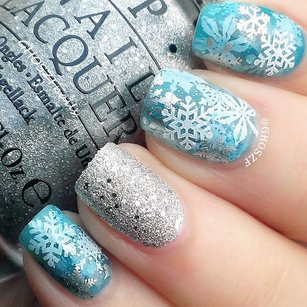 Bright colored snowflakes nail art design with sequins and glitter polish. Design your snowflake nail art into something interesting and sparkling as adding silver glitter and sequins underneath the sandwich nail art.