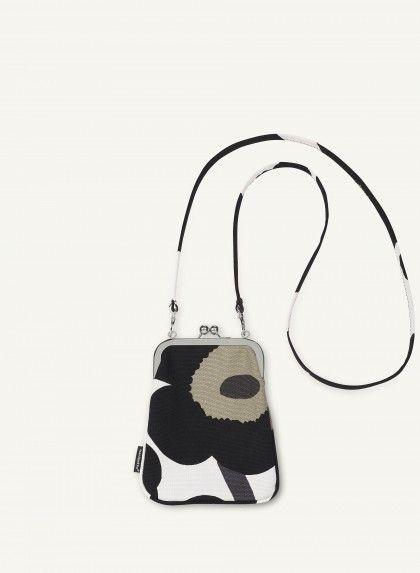 Uusi marimekon käsilaukku, mutta EI unikko-kuosi! Mieluiten sini-turkoosi pisaroi kankainen, mutta muutkin minun näkoiset käy. :)