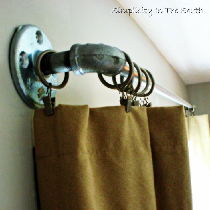 If we don't use the shutters for his windows, this is a cool idea:  Galvanized curtain rods made from plumbing supply parts
