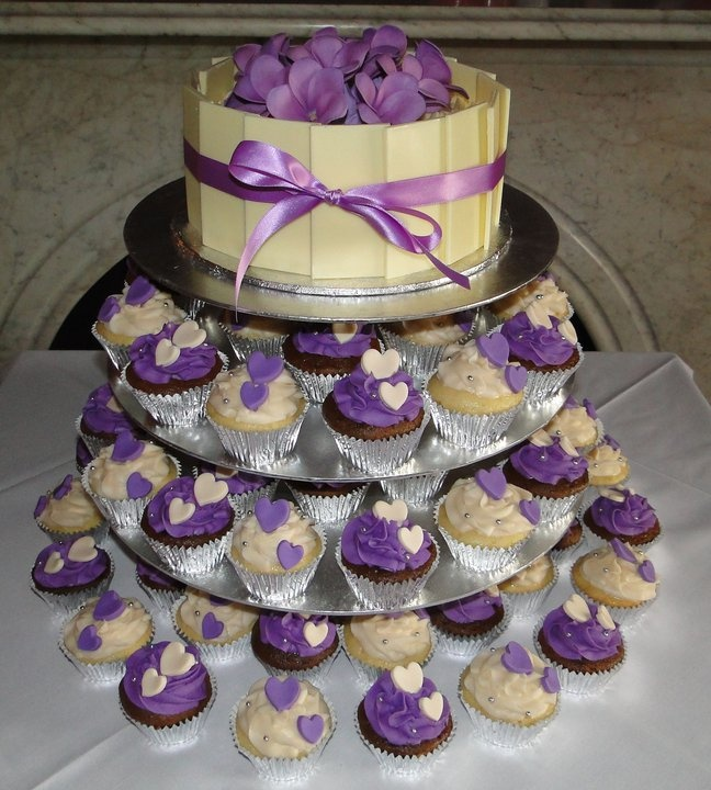 white chocolate purple frosting wedding cake and cupcakes