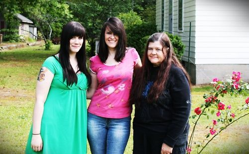 three generations of dark hair and extremely pale skin.
