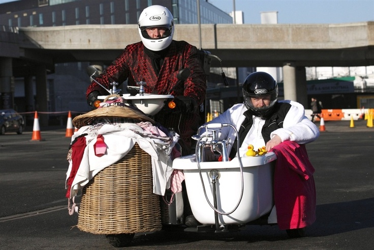 "Former England cricketer Andrew ""Freddie"" Flintoff (R) sits in a bath-tub sidecar with British inventor Edd China (L) at the controls as they try to break the fastest toilet world record at Wembley Stadium in London."