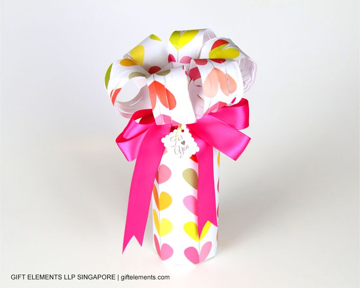 It's never too early to prepare for Valentine's Day! Watch how we wrapped a cylindrical-shaped gift that is fit for your sweetheart.  Contact us at giftelements.com for gift wrapping services and party packs!