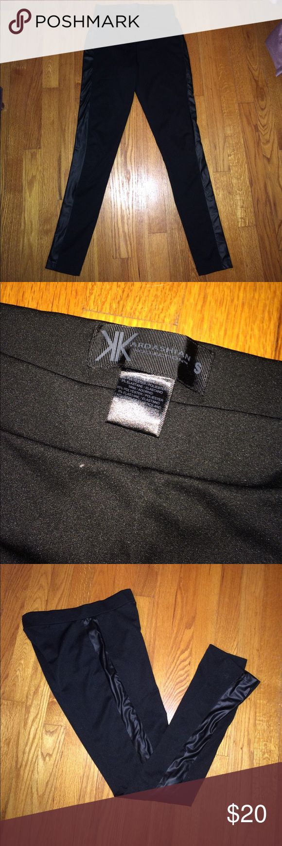 Kardashian Kollection Leggings These black Kardashian Kollection leggings have a faux leather strip down the side of each leg for a fierce look. They are super stretchy and look great! Kardashian Kollection Pants Leggings