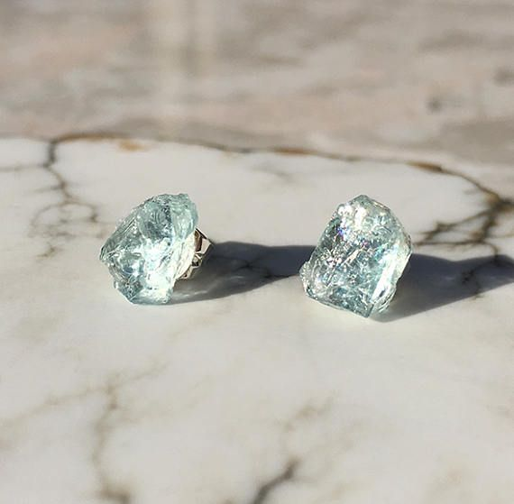These stunning stud earrings feature raw, natural aquamarine. These aquamarine crystals showcase a translucent icy ocean blue color and sparkle in the sunlight.  Aquamarine is the March Birthstone, making these earrings the perfect gift for your wife, sister, mom, or friend!
