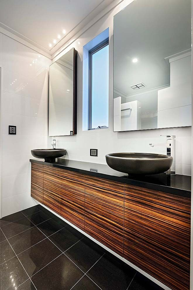sophisticated bathroom with large mirrors and shiny lights