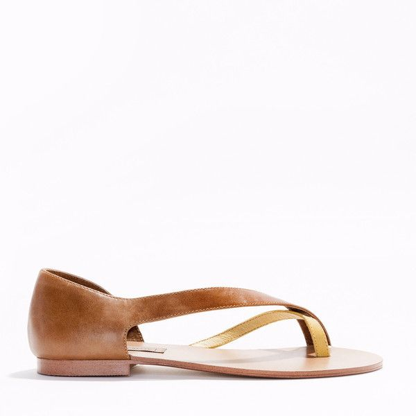 A two-tone full leather women's sandal made from beautiful leather with a diagonal strap and a contrast toe piece and a resin outsole for longer wear.