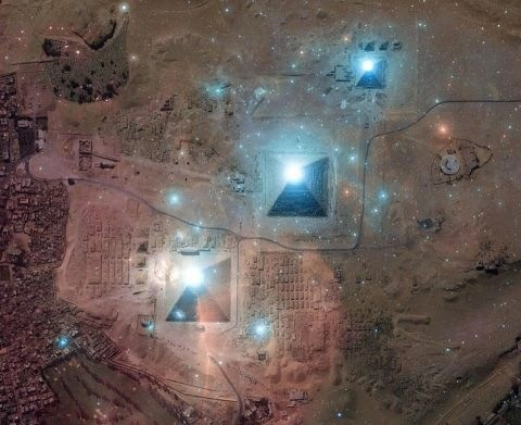 Pyramids and the stars of Orion's Belt super imposed to show the stunning accuracy of the Egyptians.   As above, so below.