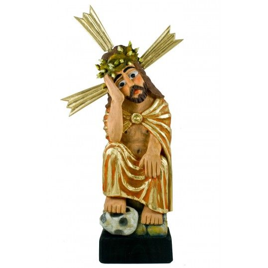 Figure of Pensive Christ carved by the folk artist Mr. Marian Bednarz. Pensive Christ (Meditating Jesus) is one of the most common motif in polish folk art.