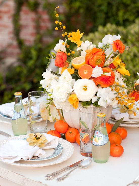 Planning a Mother's Day lunch for the moms in your life? After you've arranged your flowers, give them some extra zest by adding some fresh cut fruit. Include oranges, lemons or limes in your arrangement by simply cutting the fruit in half, sticking the uncut end into a floral pick, then gently poking the floral pick into the oasis inside the vase. Make sure to add any fruit on the day of the party so that they will stay fresh.