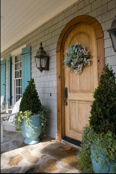 Coordinate porch decor with brightly colored shutters for a sophisticated exterior look.
