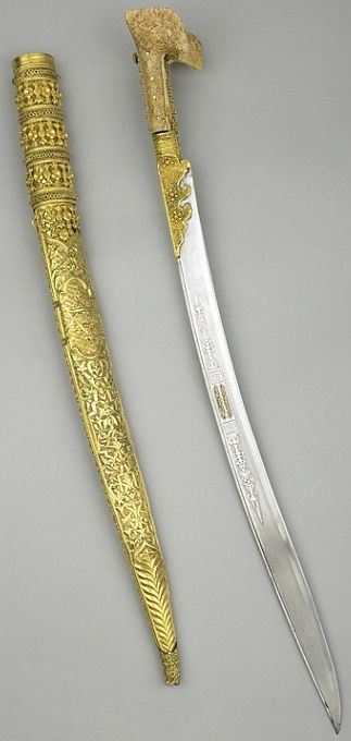 Ottoman (Balkan) yatagan / yataghan, 1820, steel, silver, gold, walrus ivory, embossed and chased, inscribed: Name of the maker, and a date, A.H 1236 (A.D.1820) Inscription: 'Property of Ahmed', Length: 60.9 cm, Wallace collection.