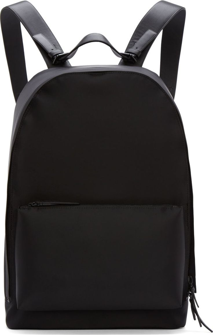 "Minimal nylon backpack in black. Tonal hardware. Over- long adjustable leather shoulder straps with criss-crossing accents at back panels. Removable carry handle at top with pin-buckle closures. Two-way zip closure at main compartment. Zippered patch pocket at front. Zippered pocket at interior with leather logo patch. Tonal stitching. Approx. 11"" length, 16"" height, 7"" width."