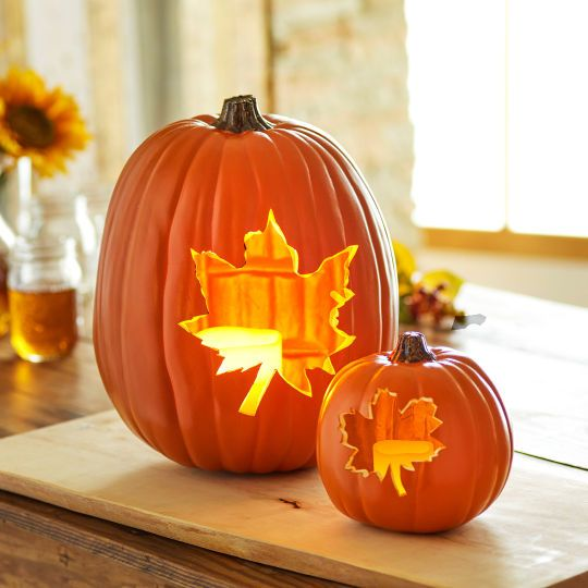 Light up your porch or home with these fall festive Leaf Carved Pumpkins.