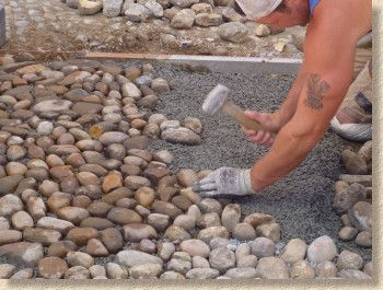 push cobblestones into the bedding concrete layer to at least half their depth.