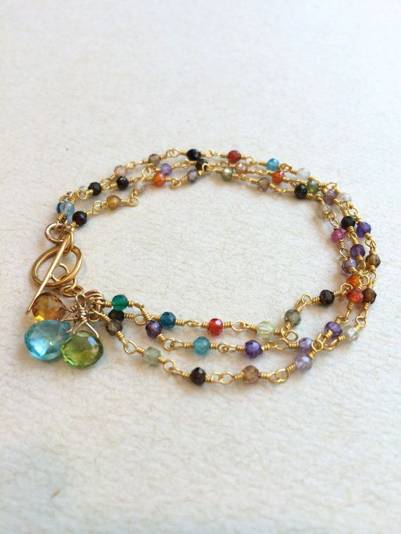 The perfect gift for mothers, grandmothers or a special friend!  3 strands of tiny sapphires, tourmalines, and cubic zirconia gemstones surround your wrist in this colorful bracelet. The gold fill toggle makes it easy to get on and off, while gemstones dangle down from the clasp. Apatite, peridot and citrine are shown in the first pic. January featured in 2nd pic. August, February, and October shown in the 3rd picture. Add your own uniquecombination of color.  Convo me with questions about…