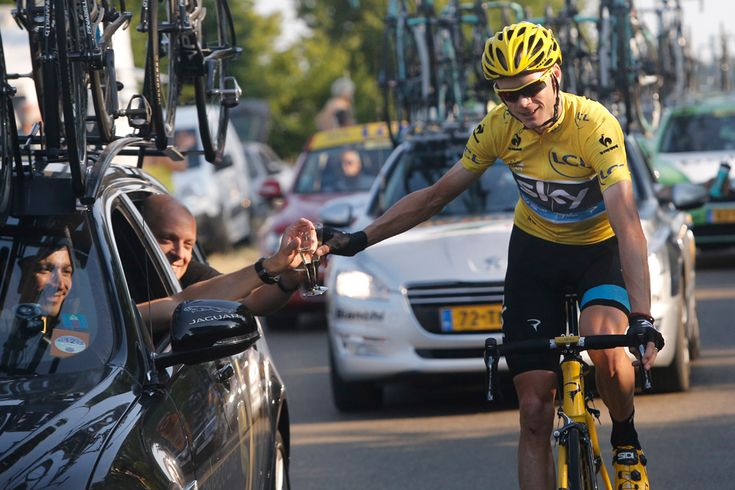 Christopher Froome of Britain, wearing the overall leader's yellow jersey, toasts with Sky Procycling team manager David Brailsford of Britain, rear left, during the 21st and last stage of the 100th edition of the Tour de France cycling race over 133.5 kilometers (83.4 miles) with start in Versailles and finish in Paris, France, on July 21. (Laurent Cipriani/Associated Press) - See more at: http://www.boston.com/bigpicture/2013/07/tour_de_france_100th_edition_p_1.html#sthash.Lx9uVNEJ.dpuf