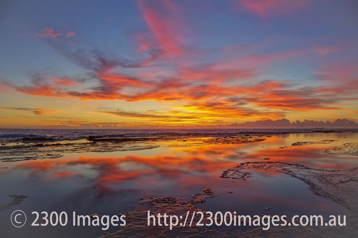 Fiery Morning Sky at Dudley Beach Rock Platform - Fiery Morning Sky at Dudley Beach, Lake Macquarie, NSW, Australia. Reflections on the rock platform at...
