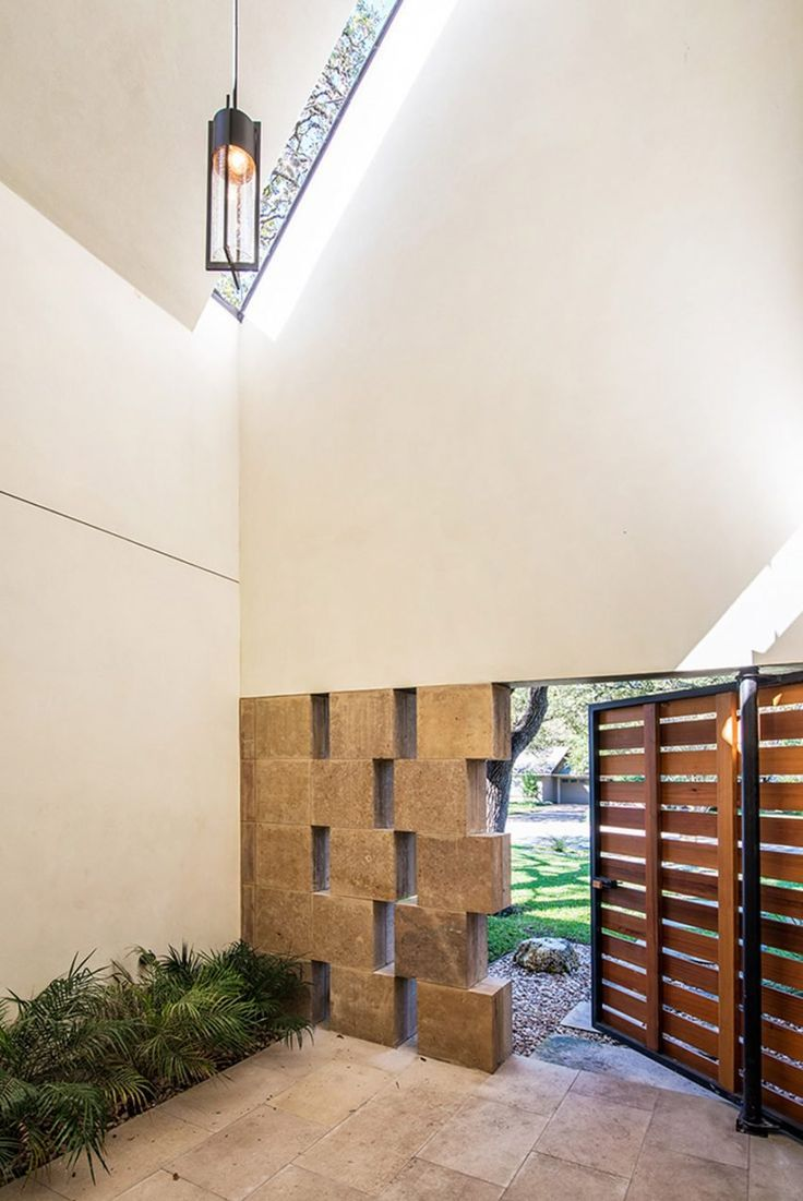 Gable wall conceals double-height atrium in Austin home by Design Hound