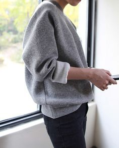 Dress up my gray sweatshirt with a black pencil skirt and boots.