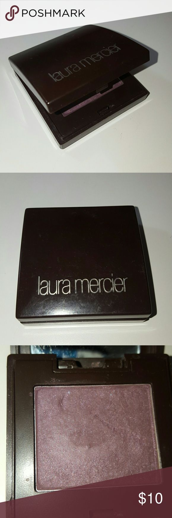 Authentic Laura Mercier eyeshadow Dark purple color. I am not really sure the exact shade since the back is all ugly now. :( Used quite a bit, but still has a ton of life left! It comes with a built in mirror! All make-up is sanitized and cleaned. Make a reasonable offer!! :) 1st picture is a stock photo and not the actual color!! Laura Mercier Makeup Eyeshadow