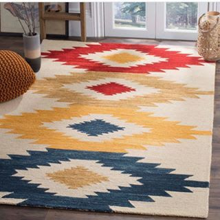 Channeling Fall with this energetic and richly-colored rug  from @dominomag  and @safavieh  . . . #kiostorage #kio #keepitorganized #closet #diy #diycloset #shelves #diyshelves #shelving #closetkit #shelvingunit #organize #organizer #tidy #homeorganizer #homeorganization #homedecor #homestorage #simplify #aplaceforeverything #declutter #easytoinstall #strong #polycarbonate #madeintheusa #sparkjoy #fall2017