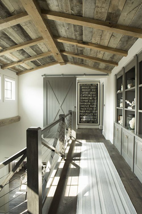 barn door to the bedrooms- hanging off the wall? is this safe? love the ceiling!