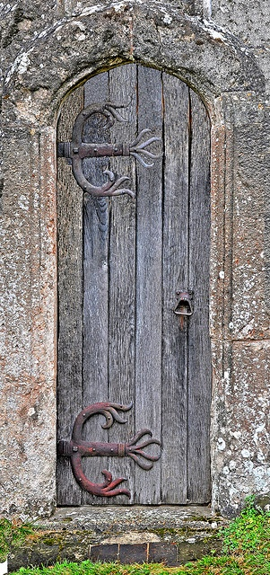 Weathered old church #door, What industrious hands carved those stones and wood planks to make the beauty jump at me?