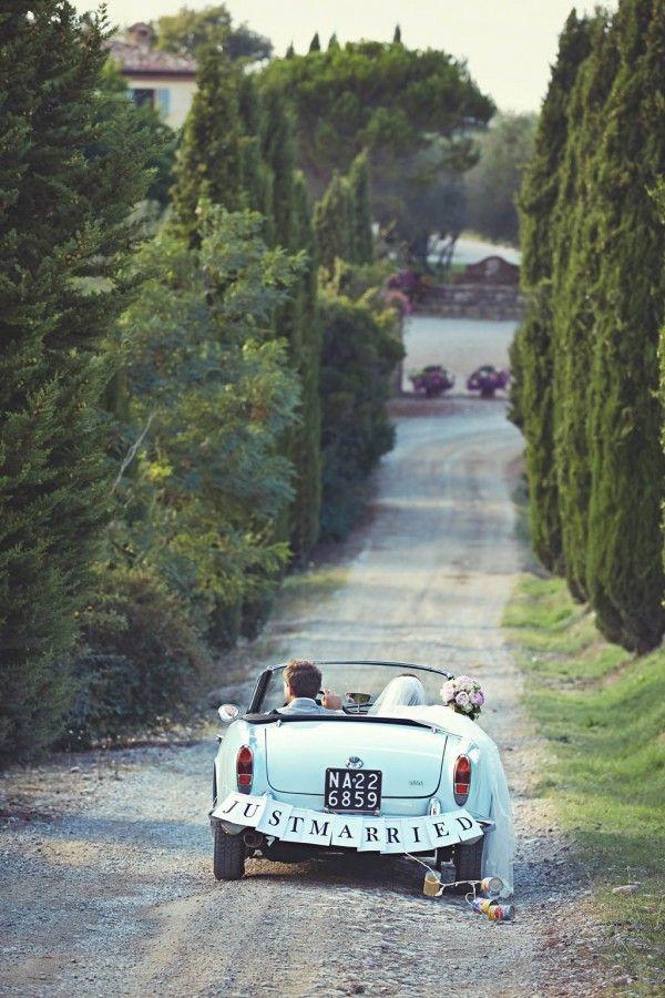 Loving this wedding send off car! Photo by Jules Bower