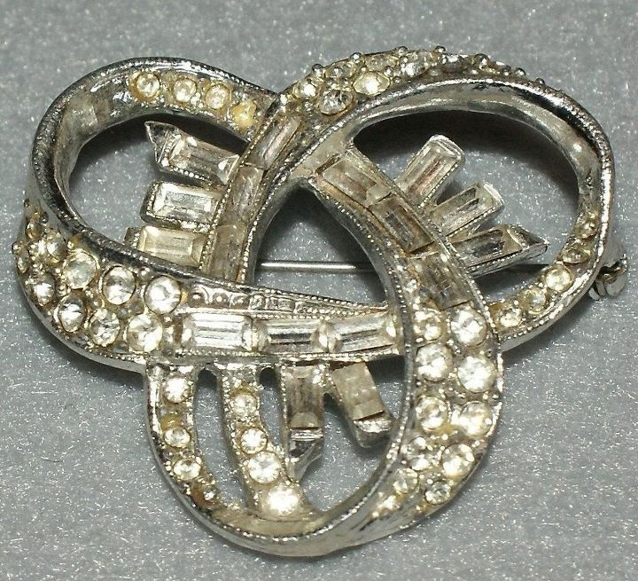 #1 Something Vintage .#modcloth #wedding - I would turn this vintage broach into a hair pin and wear it that way!