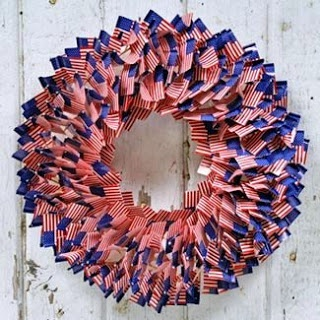 Patriotic wreath using American flag food picks. Easy way to add some 4th of July flair to your front door!