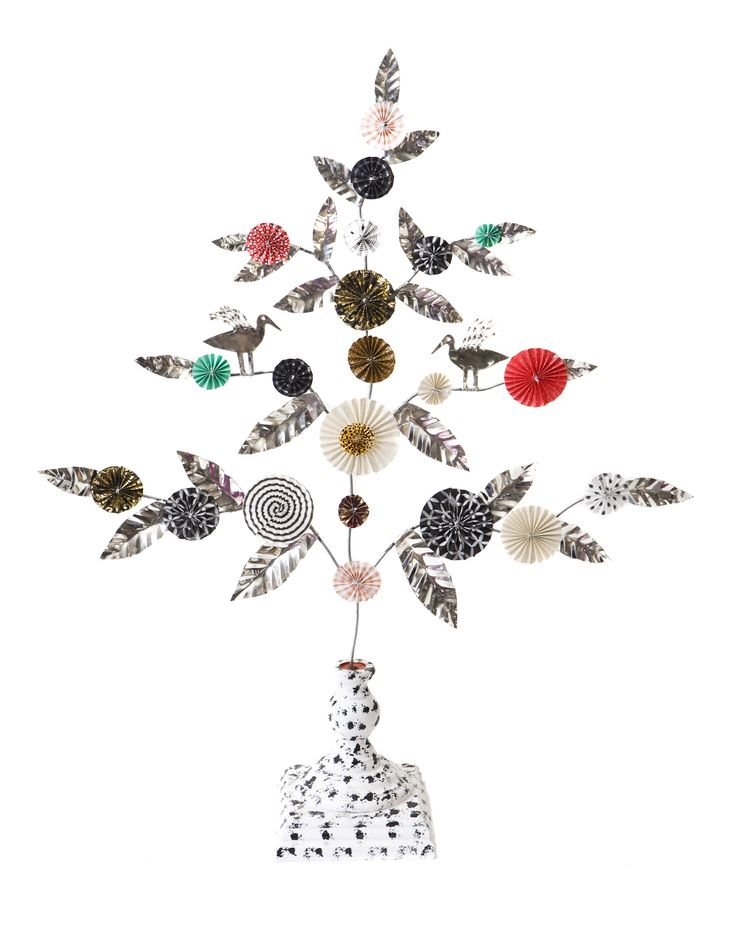 Bird Tree by Karin Ferner  Karin Ferner has worked as a silversmith with her own workshop since 1973. She designs and manufactures silver jewelry inspired by both contemporary everyday objects and traditional folk art. In recent years, she also do jewelry with a combination of silver and textiles, as well as chandeliers and candle holders of tin plates, paper and wood.  Foto: Ellinor Hall