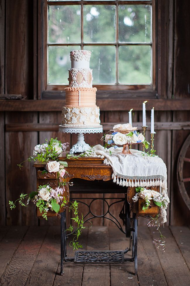 Wedding cake table inspiration featuring cake by Sugar Cubed Cake Creations, floral from East West Floral and Rentals from Something Borrowed Portland Vintage Rentals.