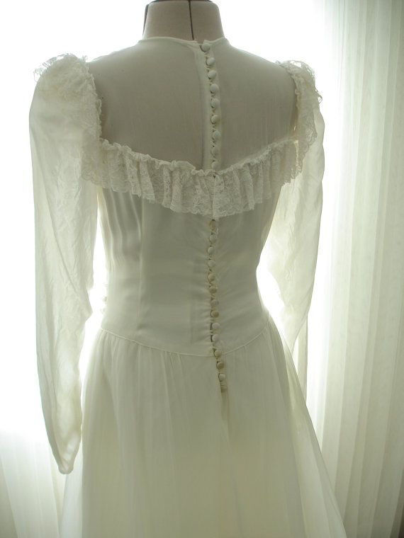 Item 110: A wedding dress dated from the late 30s early 40s. Ruched satin bodice, slim crepe sleeves, and a silk crepe skirt. The simplicity is so elegant. It does have a yoked neckline (front and back) with one row of a beautiful silk lace. Unfortunately, there are some issues with this dress so I can only claim it to be in good condition versus excellent like most of my items. I have used all the photos to show the age issues. The back yoke netting has holes by the shoulder, a small coffee…