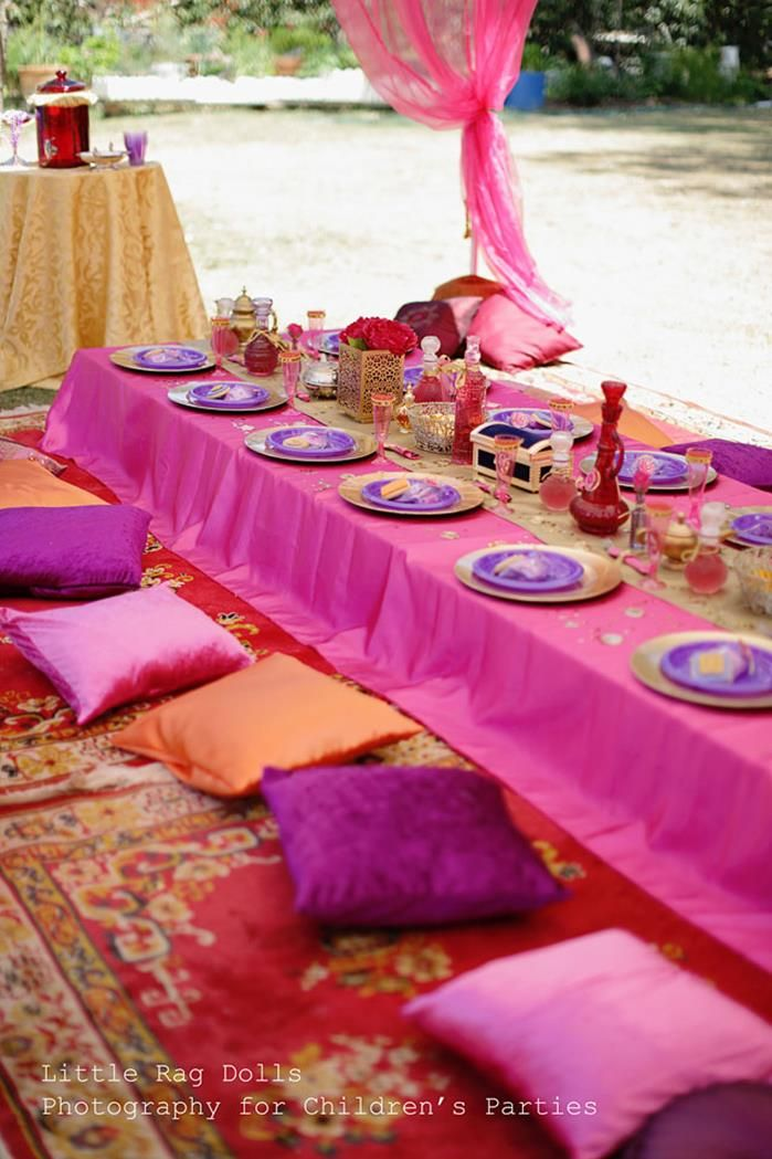 Arabian prom, instead of tables and chairs you could have the tables on the floor without the legs, pillows around