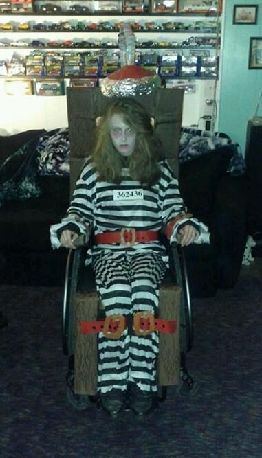 Amaris dressed as a prisoner  This is the scariest costume by far! Amaris has decorated her wheelchair to look like an old-fashioned electric chair, and she is the ghostly prisoner preparing to meet her fate.