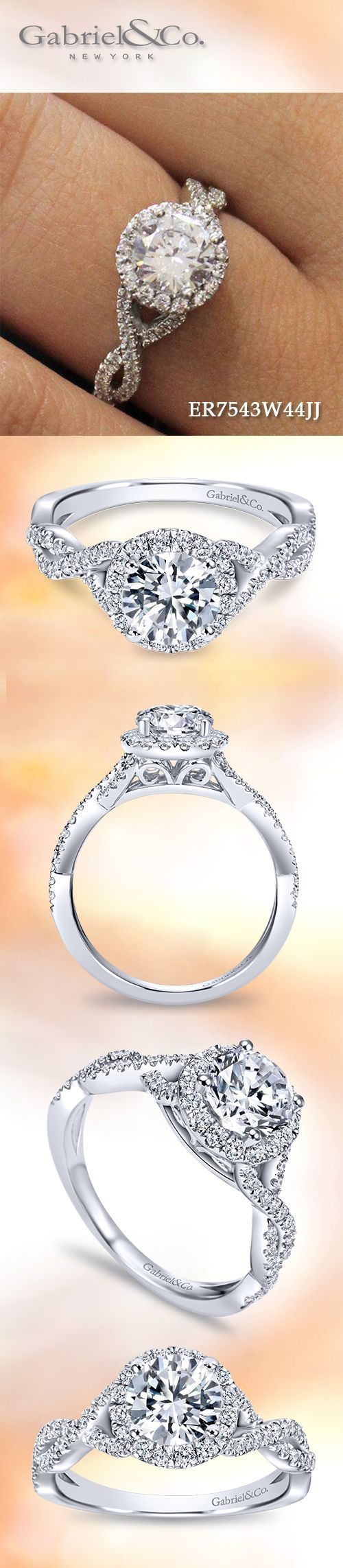 Gabriel & Co. - Voted #1 Most Preferred Bridal Brand.   With a criss cross style diamond band and diamond halo, this engagement ring will enhance your round cut center stone.