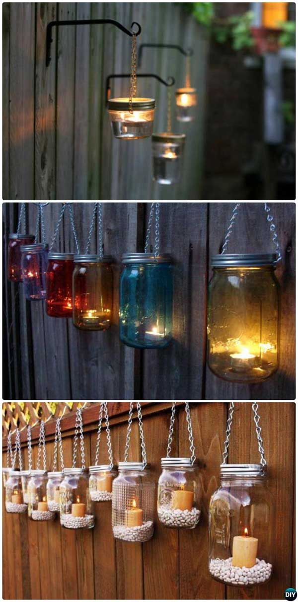 Decorate your garden fence with these DIY hanging mason jar lights.