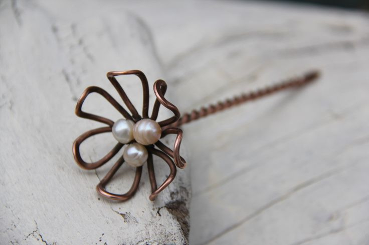 """Hair stick, hair fork, hair pin copper flower with pearls, """"Daisy"""" twisted wire wrap hair accesories by Keepandcherish on Etsy https://www.etsy.com/listing/190785448/hair-stick-hair-fork-hair-pin-copper"""