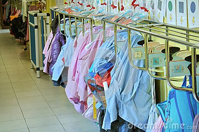 Corridor of a nursery school with aprons hanging