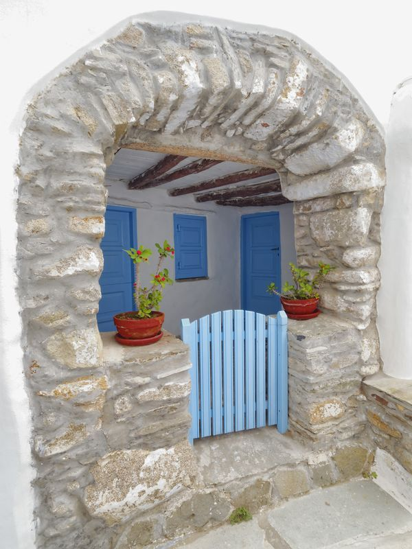 The beautiful front door of a traditional house in Tinos island, Greece