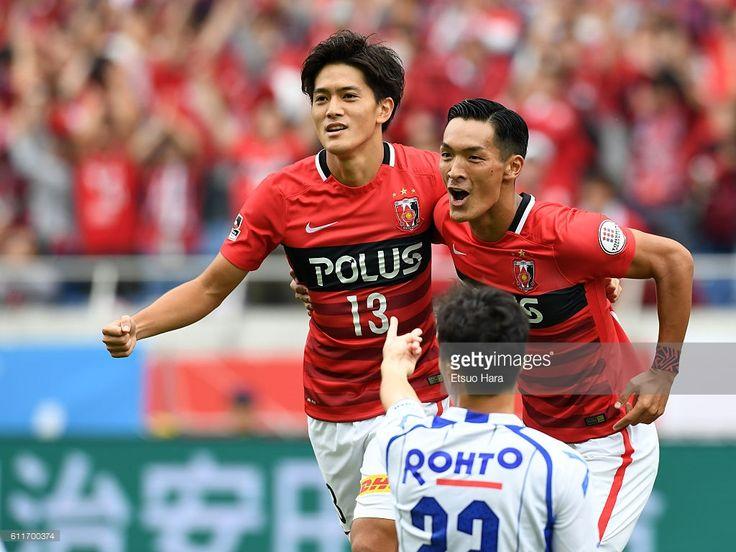 Toshiyuki Takagi of Urawa Red Diamonds#13 celebrates his team's first goal during the J.League match between Urawa Red Diamonds and Gamba Osaka at Saitama Stadium on October 1, 2016 in Saitama, Japan.