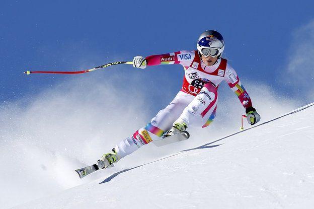 Lindsey Vonn speeds down the course during an alpine ski, women's World Cup downhill in St. Moritz, Switzerland, Saturday, Jan. 24, 2015. (AP Photo/Marco Trovati)