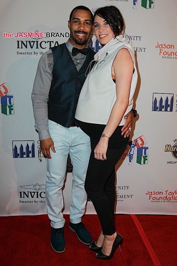 Omari Hardwick and pregnant wife Jennifer Pfautch attend a Jason Taylor…
