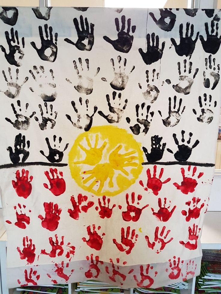 Aboriginal Flag inspired handprints