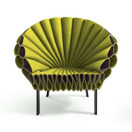 The seat is made of three layers of felt, folded and clipped in place on a metal frame.