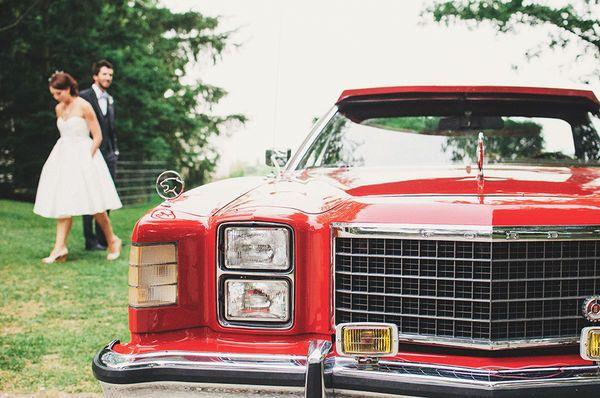 New inspiration for wedding transportation: a vintage red car.